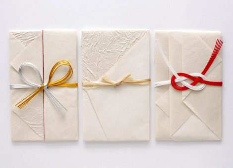 ORIGATA, the japanese art of carefully wrapping gifts in decorative paper. These carefully folded envelopes and ribbons are courtesy of Origata Design Institute
