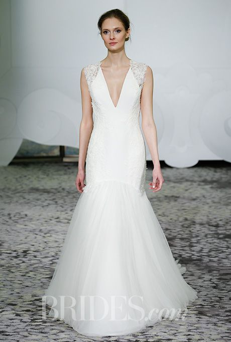Brides.com: . Gown of hand-applied mixed laces with cascading tulle train, Rivini by Rita Vinieris