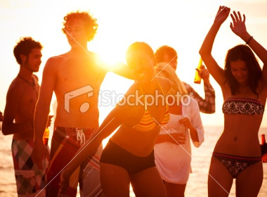 Young People Enjoying a Summer Beach Party. Royalty Free Stock Photo