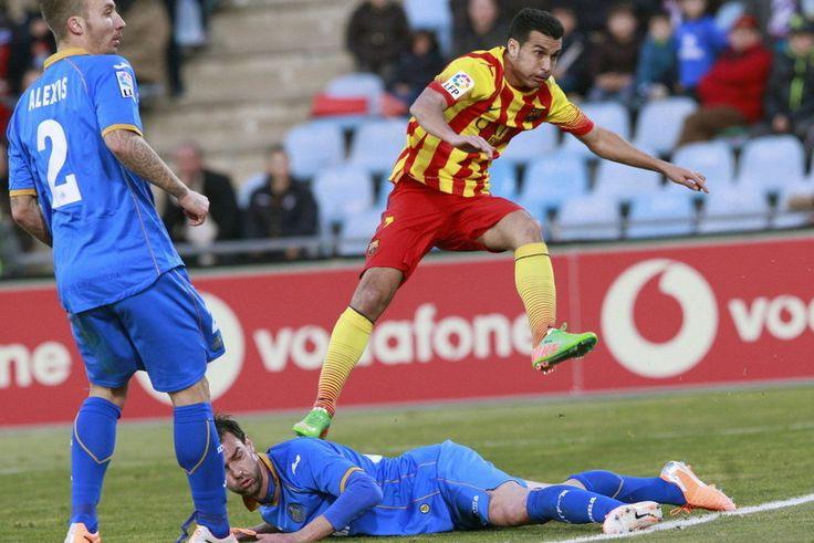El delantero del Barcelona Pedro Rodríguez tras conseguir uno de los goles de su equipo ante el Getafe