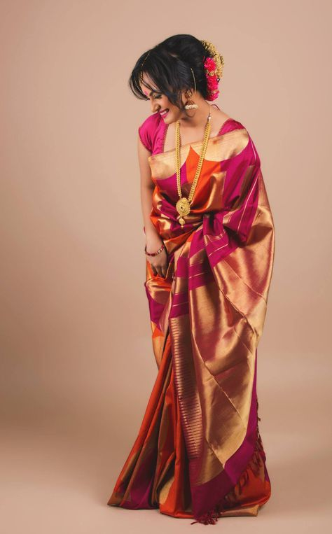 Pretty silk saree with long gold chain. Love the hairdo and jhumkis.