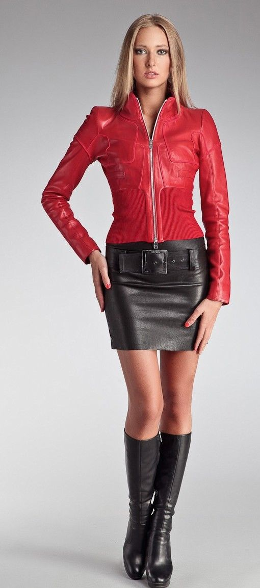 Fitted red leather jacket with belted black leather skirt and boots