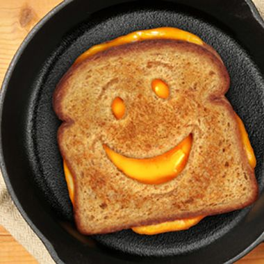 Our super smiley Cheesy Grin Bread Cutter stamps out the perfect smile!  It will leave you feeling grate!  Ideal for adding goofy grins to your grilled cheese or smirks to your salami on rye.  Anyway you look at it, they'll be the cheesiest smiles in town!