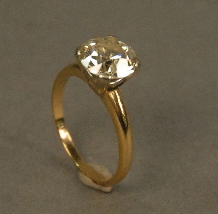 14K gold ring set with center diamond approximately 2.5cts - Realized Price: $7,200.00