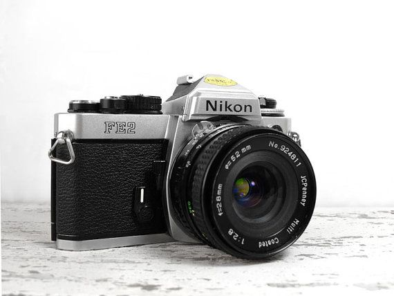 Nikon FE2 35mm SLR Camera  with 28mm 2.8 lens by VintageCameraClub