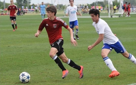 Loudoun 99 Red's club national championship run last summer gave a big college recruiting boost to Bret Halsey and his teammates. (Photo by Greg Chapman)  Brett Halsey has some advice to high school soccer players trying to get recruited: Go win a national championship. That's what worked...  http://usa.swengen.com/potomac-falls-junior-bret-halsey-commits-to-play-soccer-at-virginia/