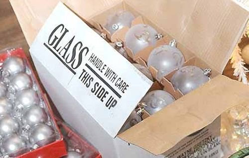 Are your Christmas decorations usually still up sometime in March? Get motivated these clever packing tips and storage ideas – and then pat yourself on the back next festive season when you unearth your beautifully organised Christmas gear! (Above: use wine boxes with dividers to store breakable ornaments)