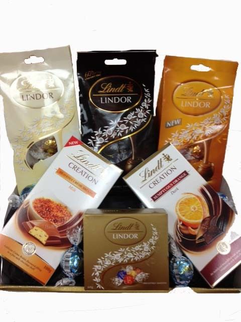 Lindt Luxury Chocolate Gift - For the true chocoholics that like to indulge in a little luxury! A selection of delicious Lindt chocolates: a Bag of White Lindt Balls 125g, a Bag of Extra Dark Lindt Balls 125g, a Bag of Caramel Lindt balls 100g, a block of Sumptuous Orange Chocolate 100g, a block of Creme Brulee Chocolate 60g and 5 Assorted Lindt balls. This yummy gift comes wrapped in cellophane with ribbon.