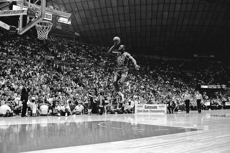 Michael Jordan of the Chicago Bulls dunks from the foul line during the 1987 NBA Slam Dunk Contest on Feb. 7, 1987, at Seattle Center Coliseum in Seattle.