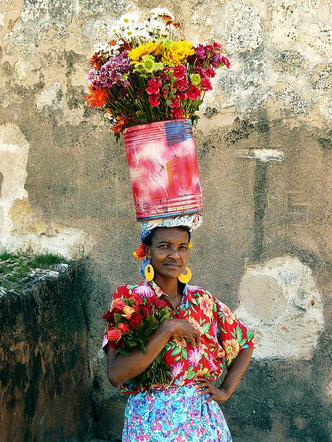 This lady was selling flowers on the street. Dominican Republic,Santo Domingo > By Alika