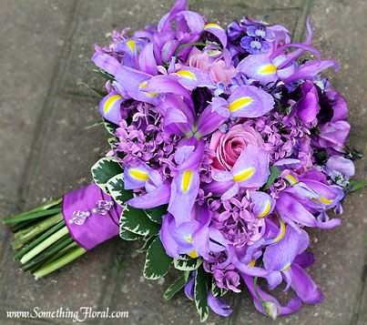 Pretty lavender and pink bridal bouquet with irises, lilacs, anemones, roses, and hydrangea. A spot-on match to Pantone's 2014 Color of the Year: ☮k☮ #radiantorchid