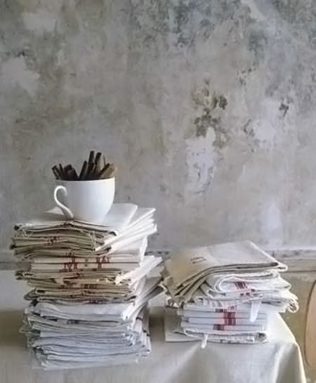 Simple and rustic linens, reminiscent of vintage French tea towels.