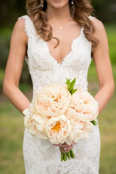 We love this romantic lace wedding dress! Simple diamond jewelry accentuates the neck line.