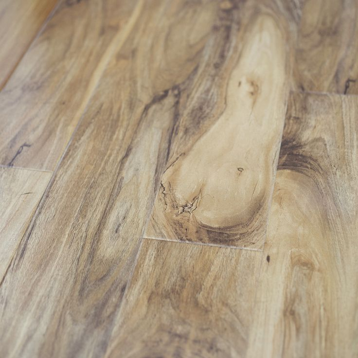 This laminate floorboard features a blend of light and for Soft laminate flooring