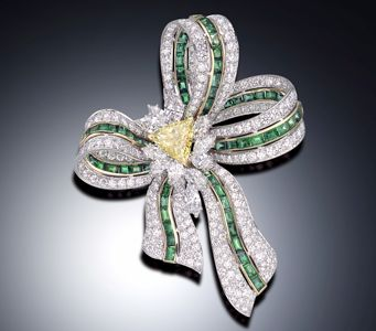 Emerald and diamond bow brooch