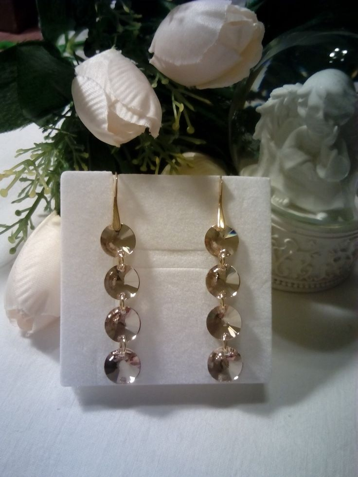 Gold plated silver earrings with silk Swarovski crystals.