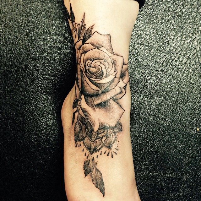Rose tattoo on the ankle.