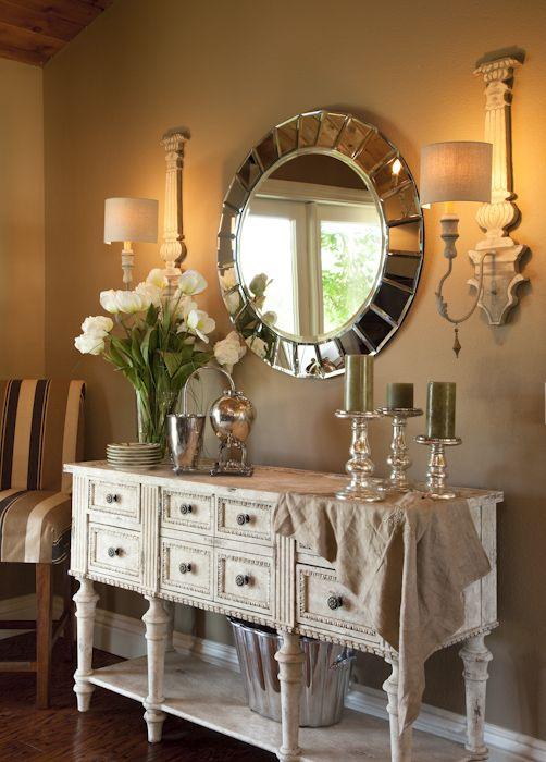 white cabinet, round mirror vignette