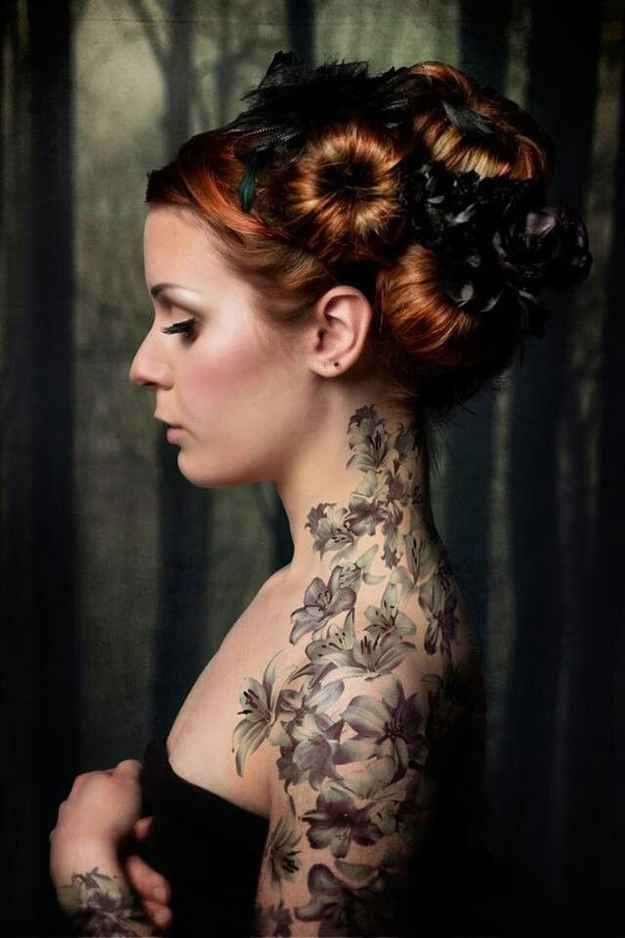 Tattoo: neck, back and arm; floral, botanical.