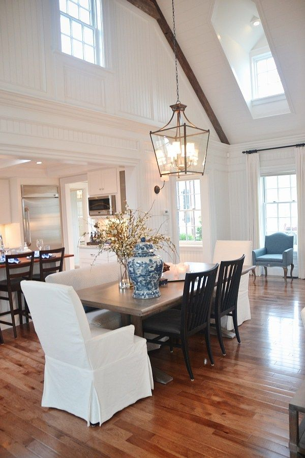 Dining room lantern chandelier and vaulted ceiling with rustic beams and dormer windows