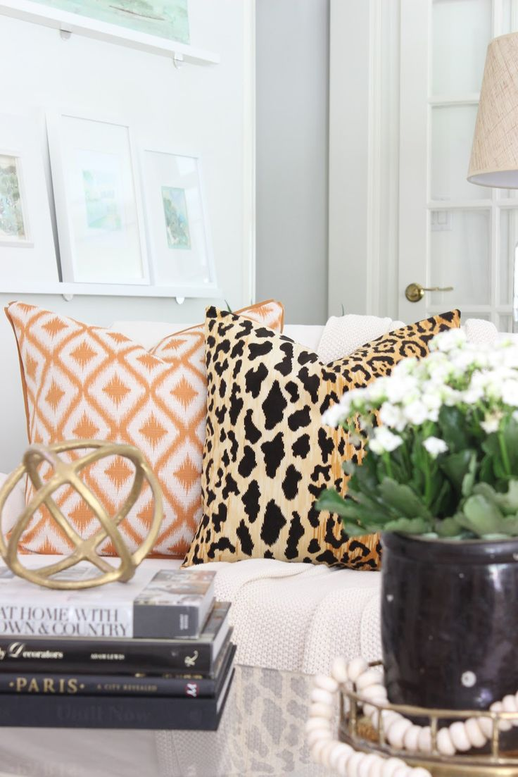 Pretty fabric patterns combinations. Easy to change the look of a room with throw pillows.
