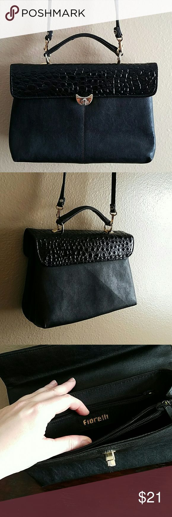 Vintage Fiorelli Handbag Excellent condition!  The gold hardware is starting to show a little wear...that is an easy fix for an overall great vintage bag. Has removable shoulder strap and several compartments for storage inside..truly a timeless classic. Fiorelli  Bags
