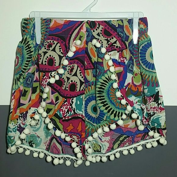 """Cute shortss with pom pom details NWOT Brand new no tags.  Playful shorts with fun pom pom details around the edges. Pair with your favorite top and sandals!  Multi colors 100% rayon  Length approx 11.5"""" Waist when laid flat side to side approx 13"""", elastic waist band allows for stretch Size small  Price is firm no trades Shorts"""