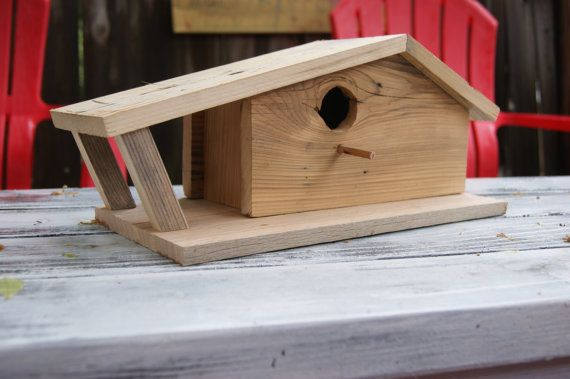 I built this funky birdhouse as a demonstration to accompany a talk that I gave on woodworking projects that use found & reclaimed materials. It