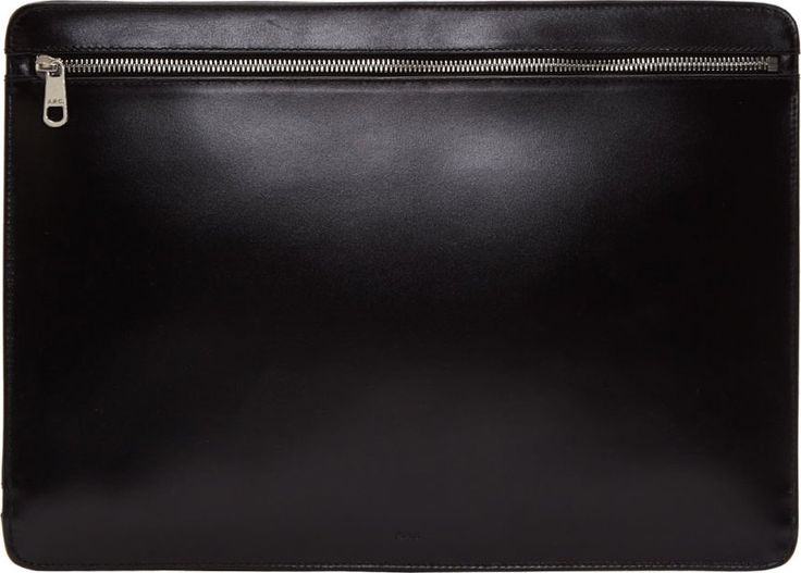 "A.P.C. Leather document holder in black. Silver-tone zippered compartments at both faces. Logo embossed at front face. Lined in black textile. Tonal stitching. Measures approx. 14.5"" length x 10.75"" height."