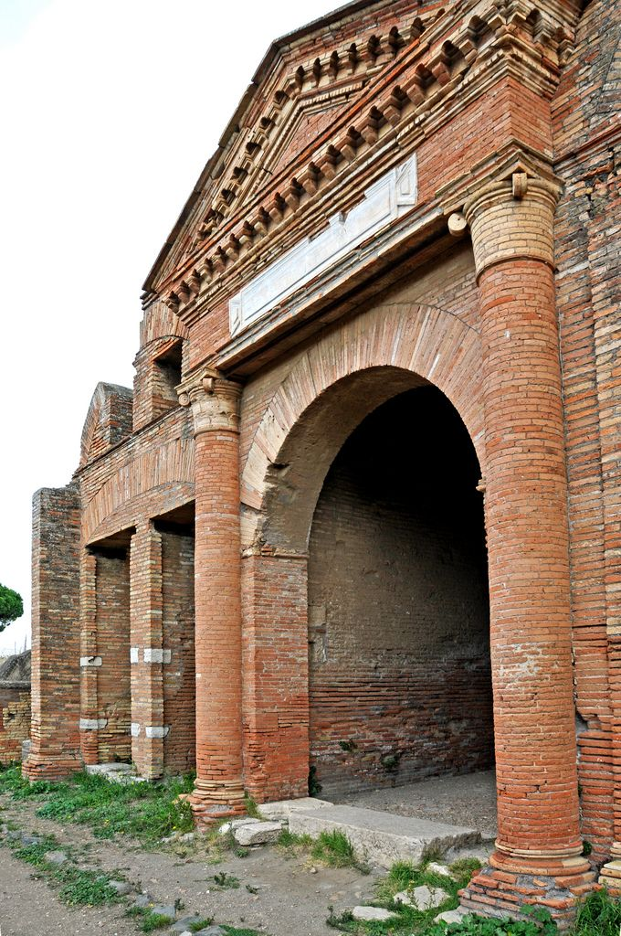 The Temple of the Ship-Carpenters was built on top of a fullery (workshops where clothes were cleaned). Ostia and Portus each had its own guild of ship-carpenters. The guilds had hundreds of members, which suggests that ships were not only repaired in the harbours, but also built. The temple dates from the end of the 2nd century A.D. In the 4th century A.D., when commercial life shifted to Portus, the association declined and the temple became a depository for marble.