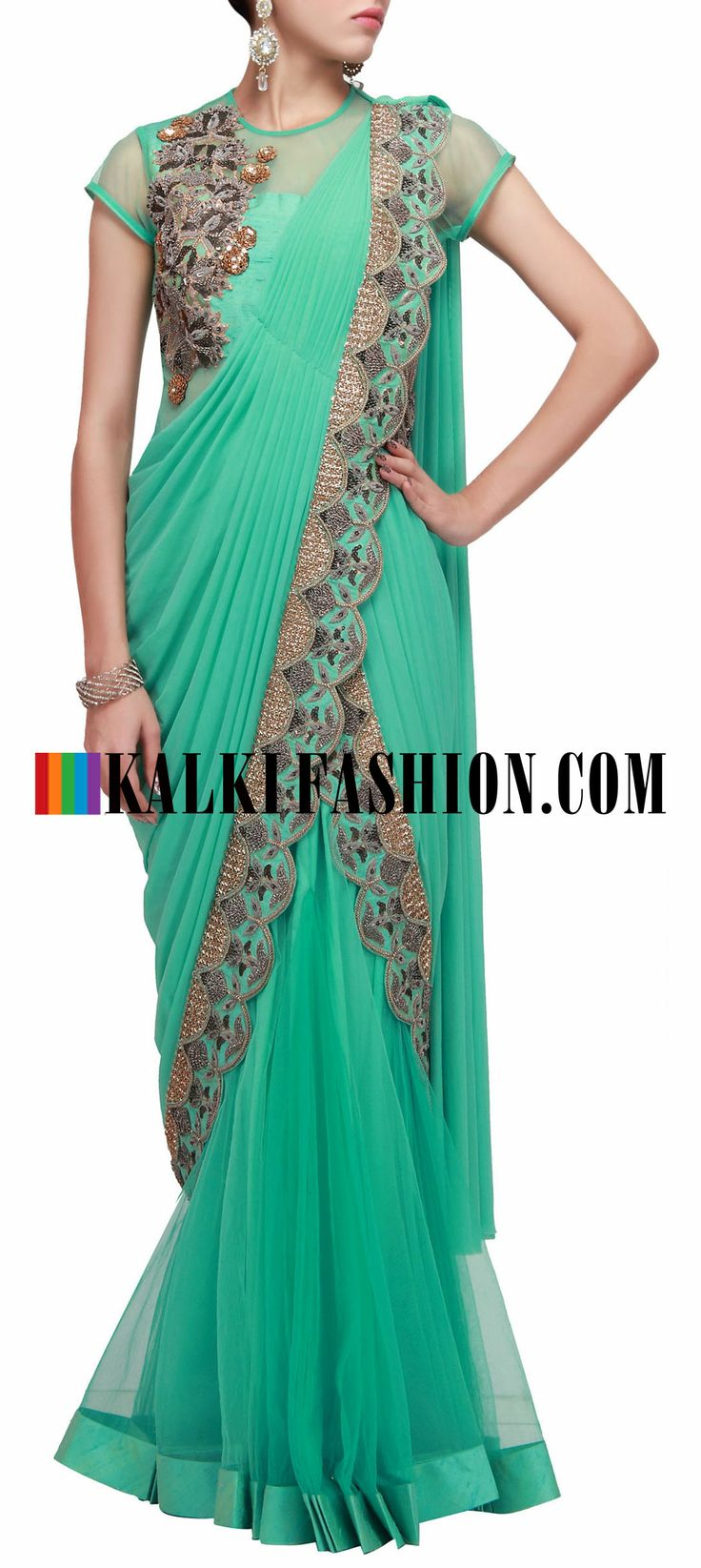 Buy Online from the link below. We ship worldwide (Free Shipping over US$100) http://www.kalkifashion.com/featuring-pre-stitched-saree-gown-in-turq-embellished-in-zardosi-only-on-kalki.html Featuring pre stitched saree gown in turq embellished in zardosi only on Kalki