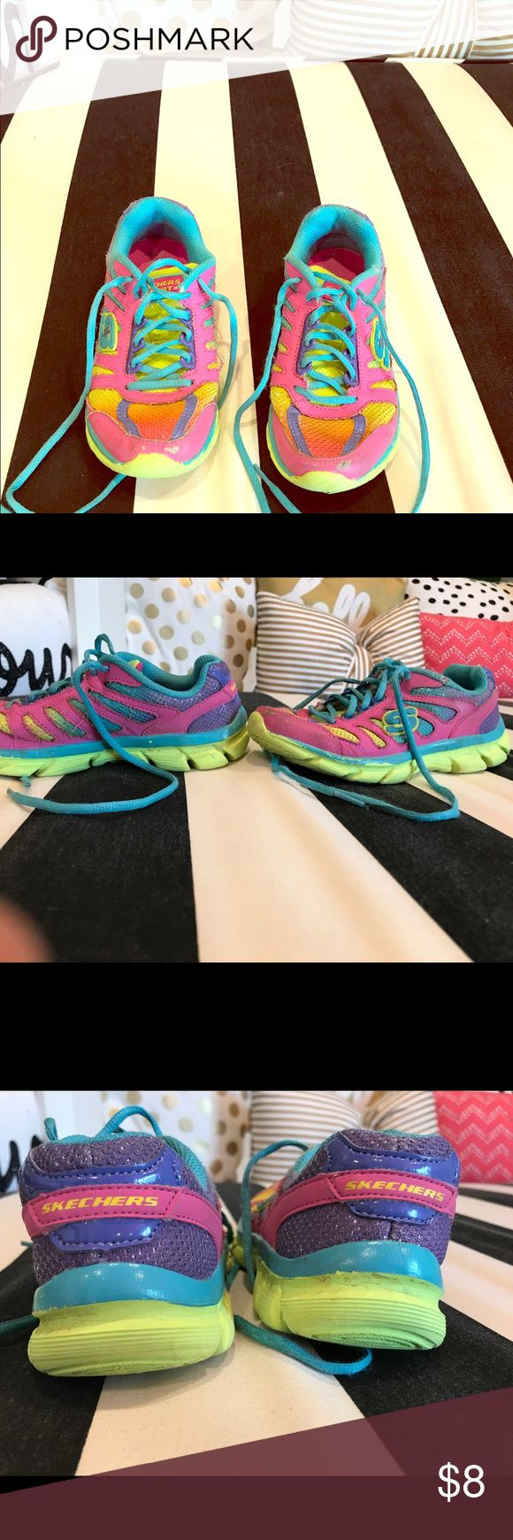 Girl tennis shoes size 13 Skechers brand size 13 girls tennis shoes. Very pretty colors! Pink, blue, orange and yellow. Has a few signs of wear, mainly on the tip of the toes. Skechers Shoes Sneakers