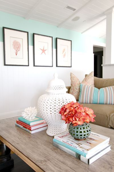 White walls, pop of color, black and white frames