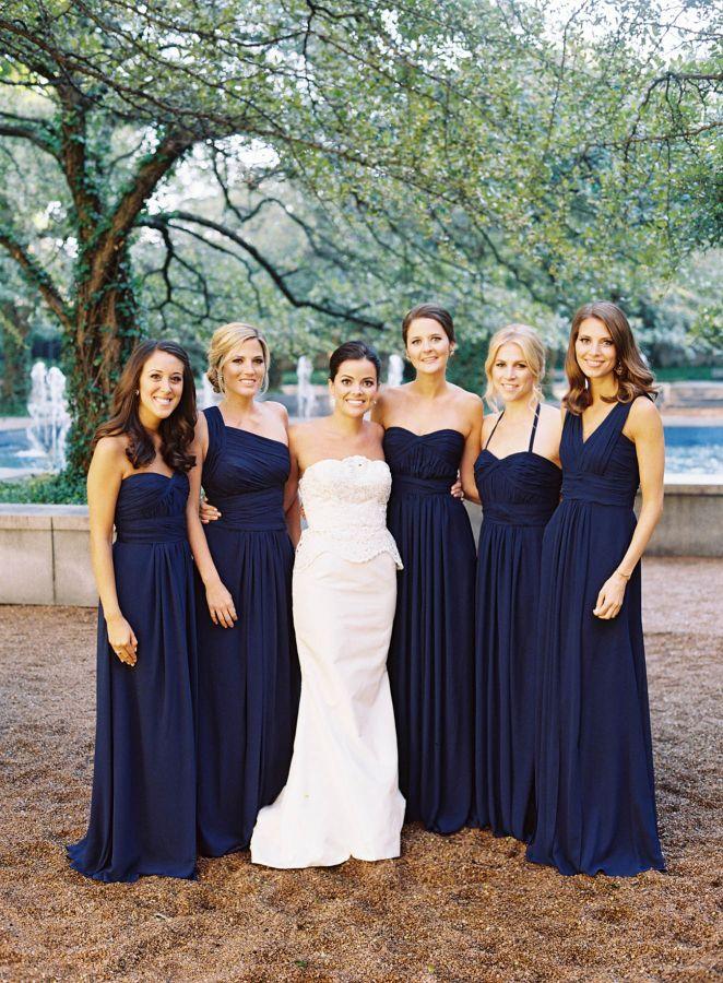 Elegant navy blue bridesmaids' gowns: http://www.stylemepretty.com/2016/02/15/classic-chicago-wedding-at-the-rooftop-terrace-in-millennium-park/   Photography: Tec Petaja - http://tecpetajaphoto.com/