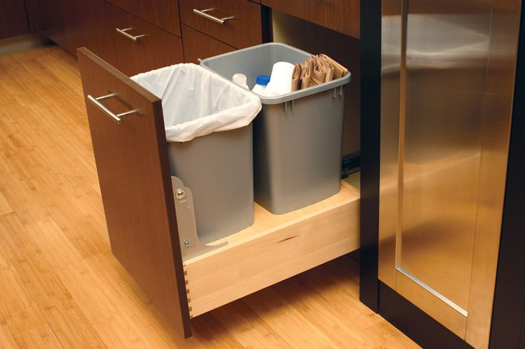 That cavernous area under the sink can be outfitted with tiered shelves and racks, while the cabinet next to the sink can be specified with a double pull-out for trash and recycling bins.