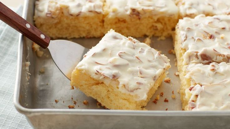 Part pound cake, part poke cake, Betty's take on the Kentucky Butter Cake features an irresistible buttermilk cake, a homemade cream cheese glaze poured over top, and is finished with toasty almonds (and more glaze, of course).