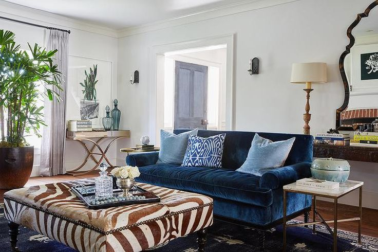 Wonderfully Styled Living Room Boasts A Jewel Blue Velvet Roll Arm Sofa Paired With Sky