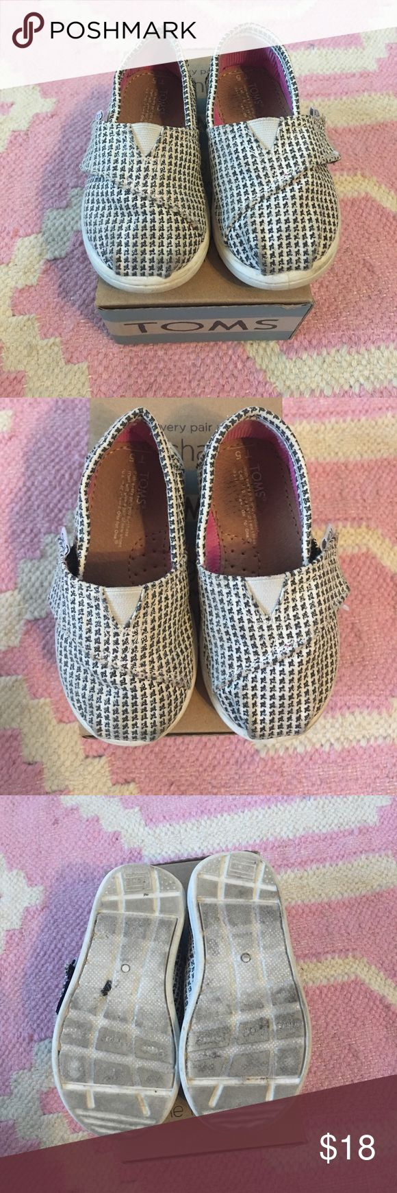 Tiny Toms - silver herringbone - 5 toddler Classic Tiny Toms - sliver (sparkly) herringbone- size 5 toddler. Gently used with some slight signs of wear on toes Toms Shoes