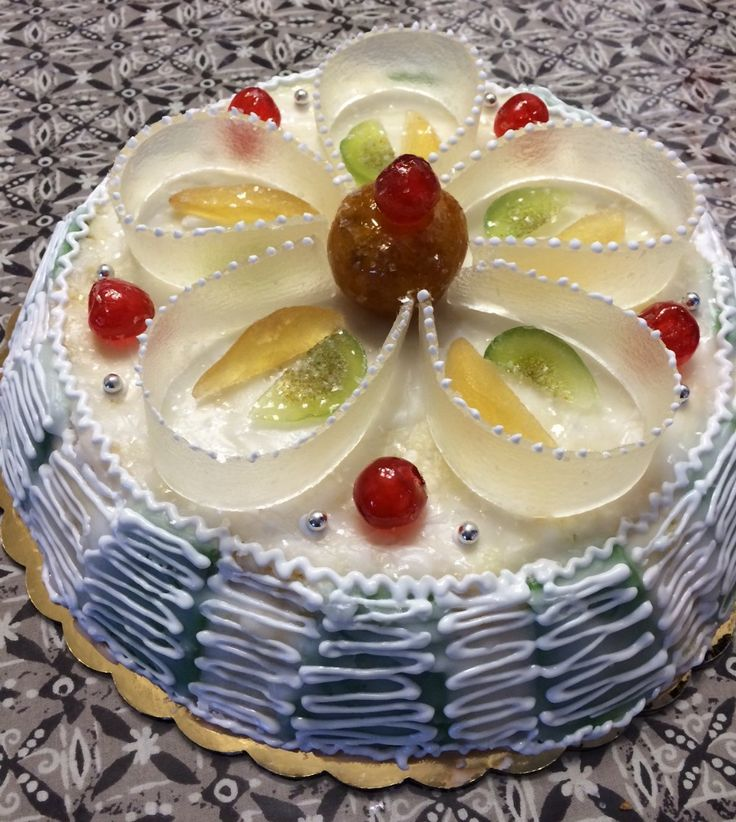 """This is a Sicilian Cassata made with a Pan di Spagna (sponge cake) filled with cannoli cream, wrapped in pistachio marzipan, covered in Italian fondant icing and adorned with candied fruit from Sicily. The pan is an authentic cassata pan from Italy. This pan is 12"""" across. You can easily use a regular cake pan if you don't have a Cassata pan."""