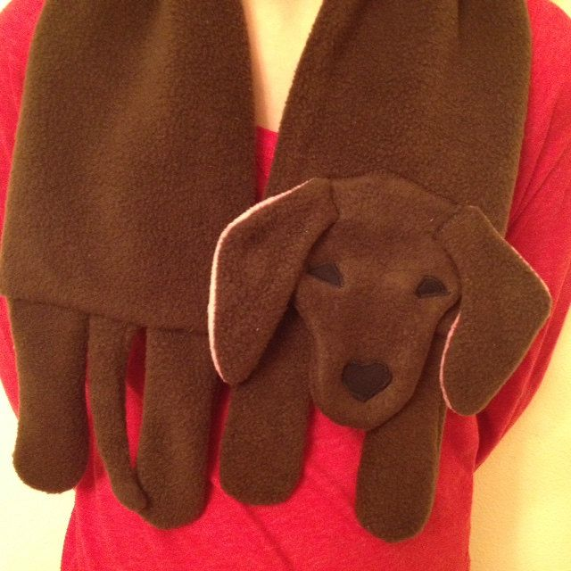 Who wouldnt love this adorable dachshund scarf!! This is a PDF pattern that you download and print at home. Scarf can be made in lengths up to 60 inches or as small as you like. Dogs ears hang freely. Eyes and nose are machine appliquéd but this is not necessary when using fusible webbing! It is made using fleece and cotton straps. Materials list is included as well as written detailed instructions and full sized photos!  Look for these other scarf patterns: Horse, Fox, Bear, Moose, Owl…
