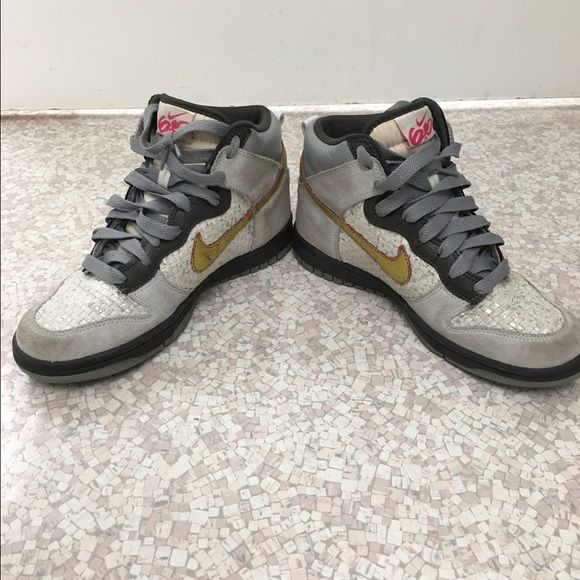 Nike 6.0 women's high top sneakers Nike 6.0 women's high top sneakers, size 7. Grey, white, black, and gold. Love these, used but in good condition. Only real sign of wear is on portions of grey suede area. Feel free to make an offer! Nike Shoes Sneakers