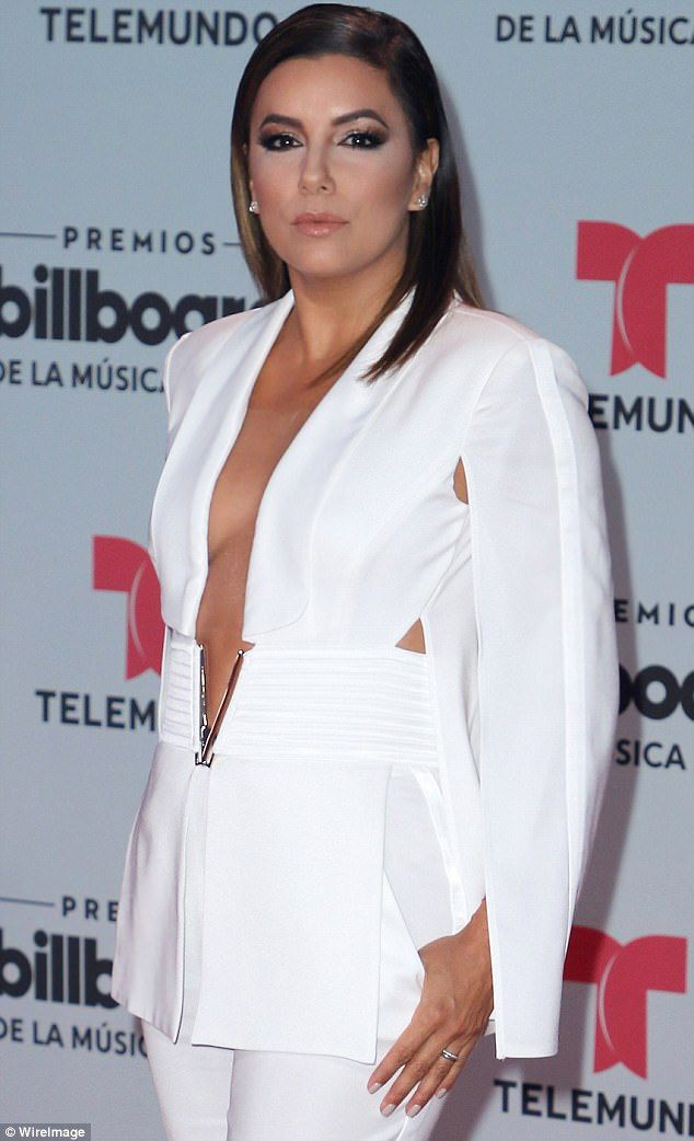 Just nipping out: But thankfully the Latina lovely did not suffer an wardrobe malfunction...