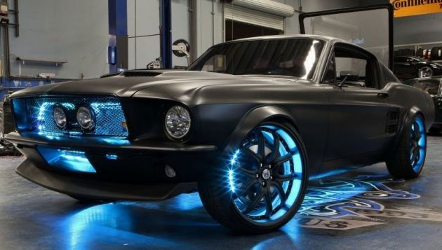 Microsoft, together with West Coast Customs, have put together an unusual creation: A 2012 Ford Mustang, albeit with a 1967 replica body in a matte black finish, and as much Microsoft-powered tech as possible.