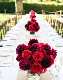 Love how simple and clean the bouquets down the table look. Much less cluttered than the normal runner, several centerpieces, and candles.