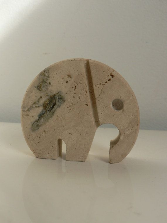 Secret Eyes Only's vintage 1970s modernist travertine elephant stone art animal sculpture by Fili Mannelli while looking thru Etsy Seller Haus Pround's favorties.
