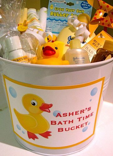 Bath Time Bucket !! - A fun and different BABY GIFT ( Shower ) ... filled with all sorts of bath goodies– soap, lotion, diaper cream, wash cloths, brush and of course, a rubber ducky.