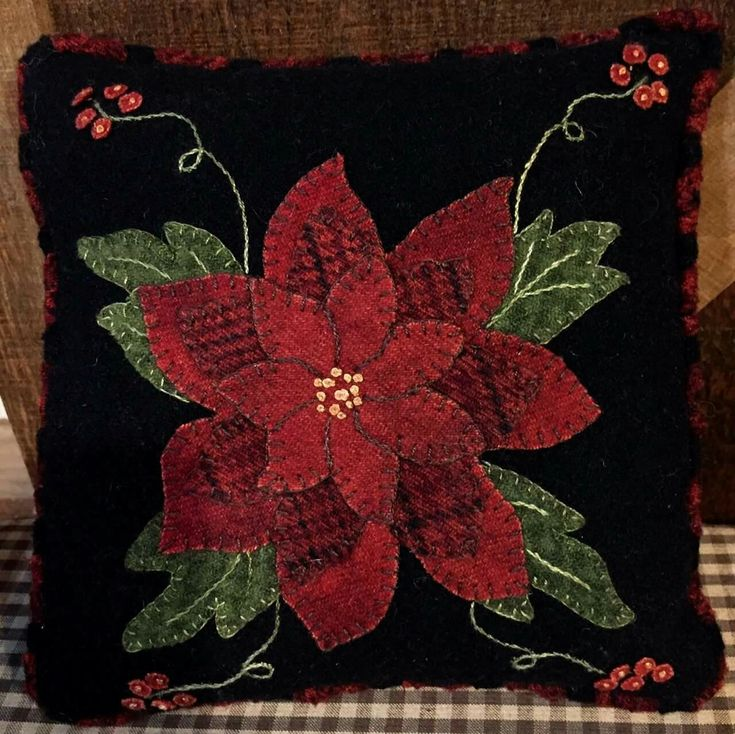 Beautiful wool appliqué poinsettia pillow!