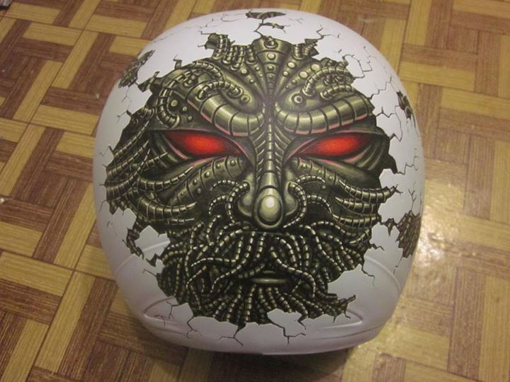 """Tri Wahana, - """"Eggs"""", - acrylic and mixed media on helmet."""