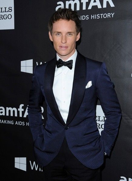 Eddie Redmayne in TOM FORD O'Connor navy blue jacquard cocktail jacket. Satin black shawl collar w/boutonniere, white plain front evening shirt w/classic collar, black silk bow tie, and white linen pocket square.