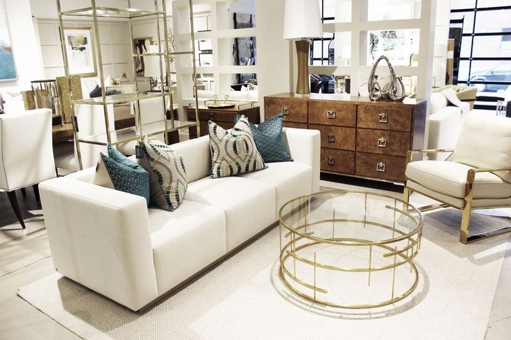Gold cocktail table, burl wood dresser and modern sofa  http://www.avenuedesigncanada.com